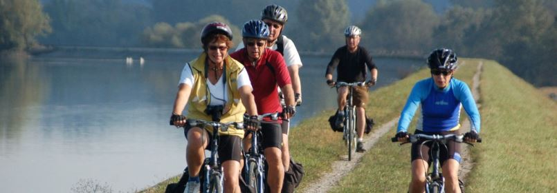 Cycling-Holiday-in-Slovenia-Group-of-Cyclists-on-the-Riverbank
